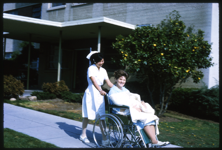 Here's Margaret Norman (Charles' mother) being wheeled out of O'Connor Hospital with the newborn baby, Charles.